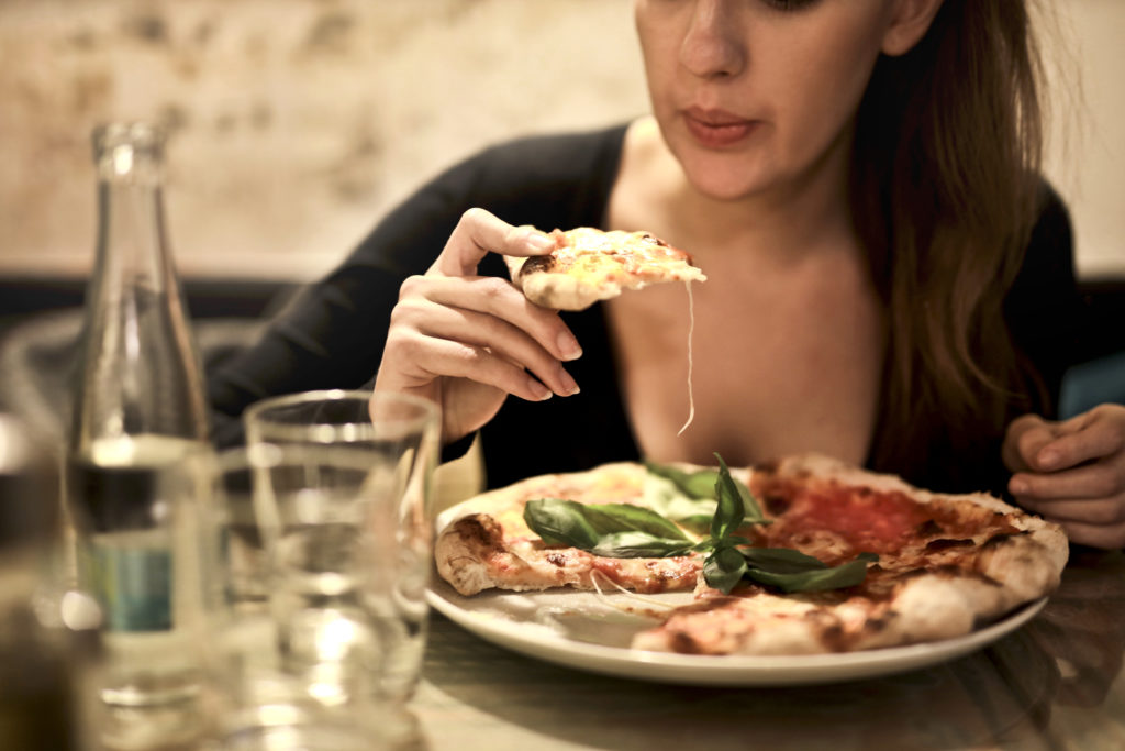 woman eating a big meal