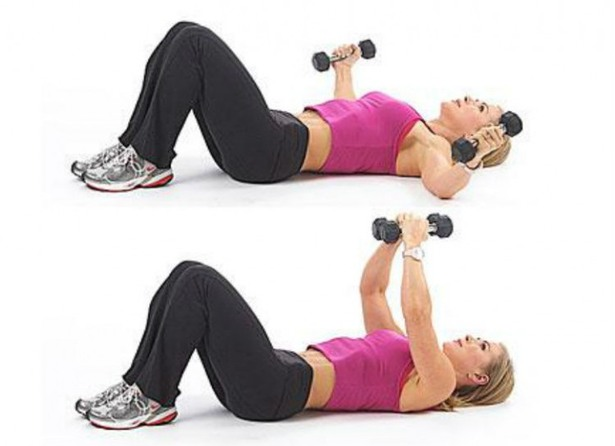 woman doing dumbbell fly exercise
