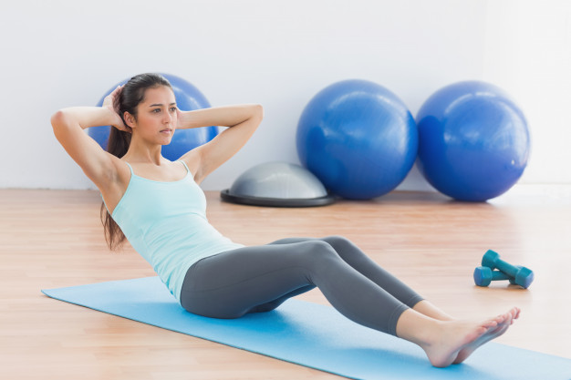 determined-woman-doing-sit-ups