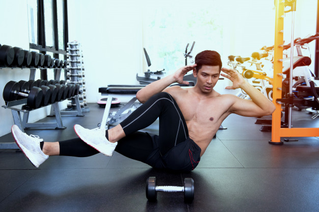 fit-man-doing-bicycle-crunches