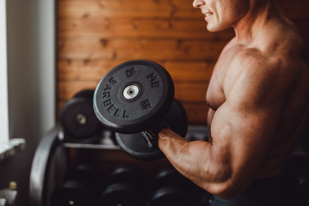 Man doing bicep curls exercise