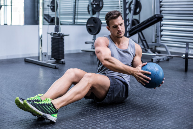 muscular-man-doing-russian-twist-exercises_