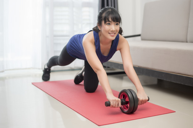 woman doing ab roller exercise