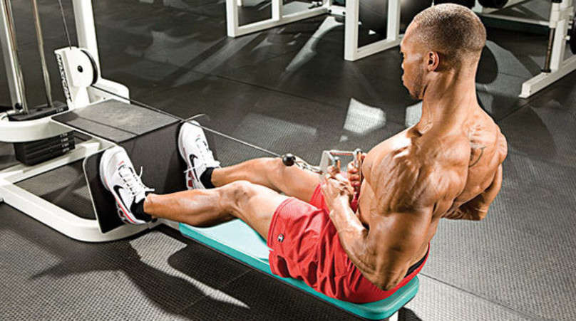 man doing seated cable row exercise