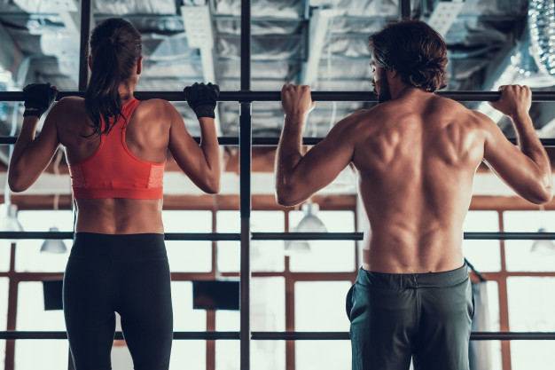 girl and guy doing pull ups exercise