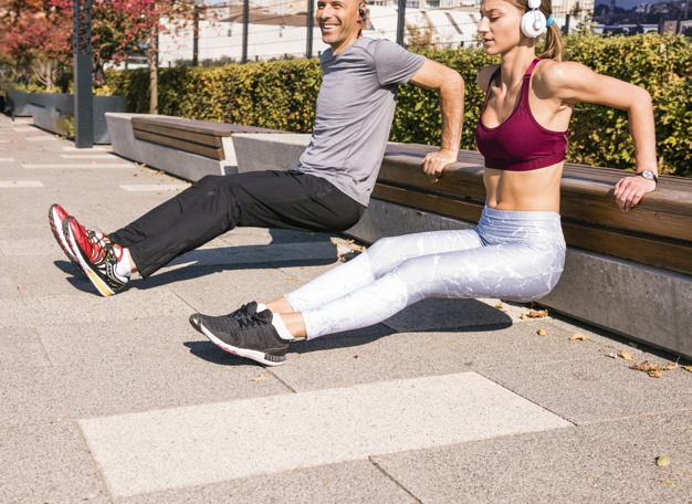 happy couple doing triceps dips exercise