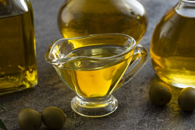 close-up-cute-cup-filled-with-olive-oil