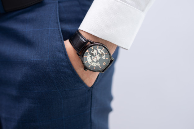 close-up-male-wearing-luxury-stylish-wristwatch