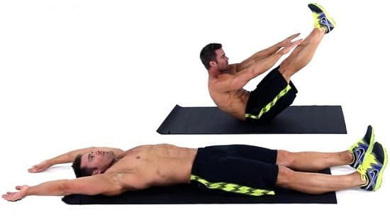 fit man doing V-up exercise for abs