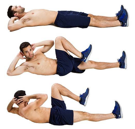 fit man doing bicycle crunches