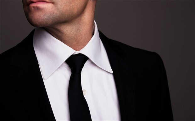 man with suit and tie half face