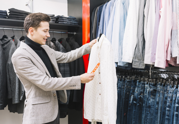 young-man-shop-checking-price-tag-business-casual-shirt
