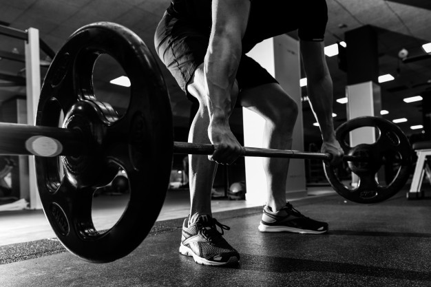 fit man weight lifting barbell