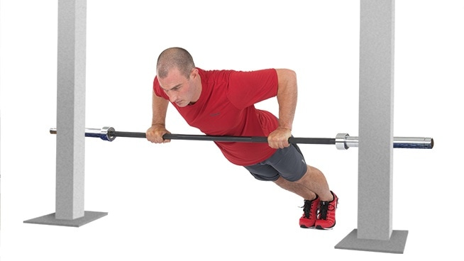 fit man doing barbell push up