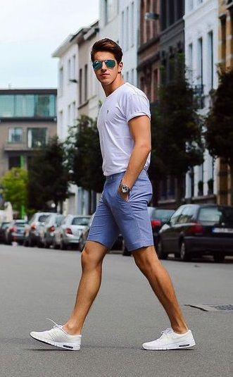 handsome guy wearing chinos shorts white sneakers