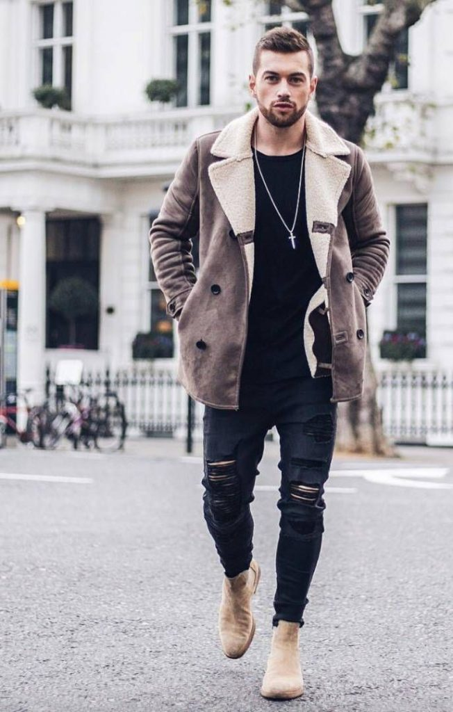 lather boots windy winter day handsome man ripped jeans walking