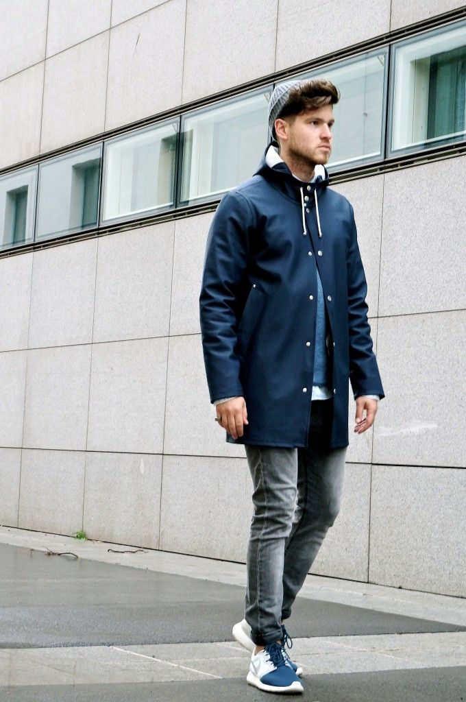 man walking footpath rain coat style fashion
