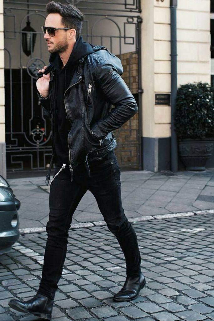 man wearing black leather jacket and black boots jeans denim winter