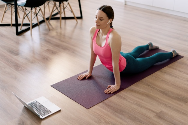 woman doing exercise yoga mat bedroom