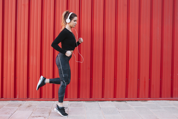 woman running workout headphones