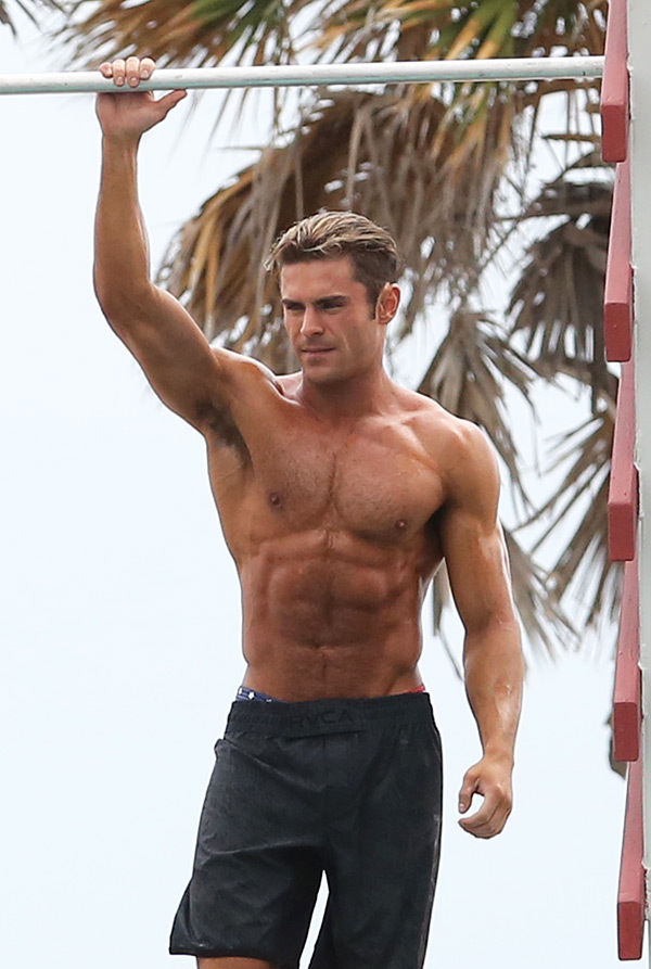 Zac Efron standing pull up baywatch body