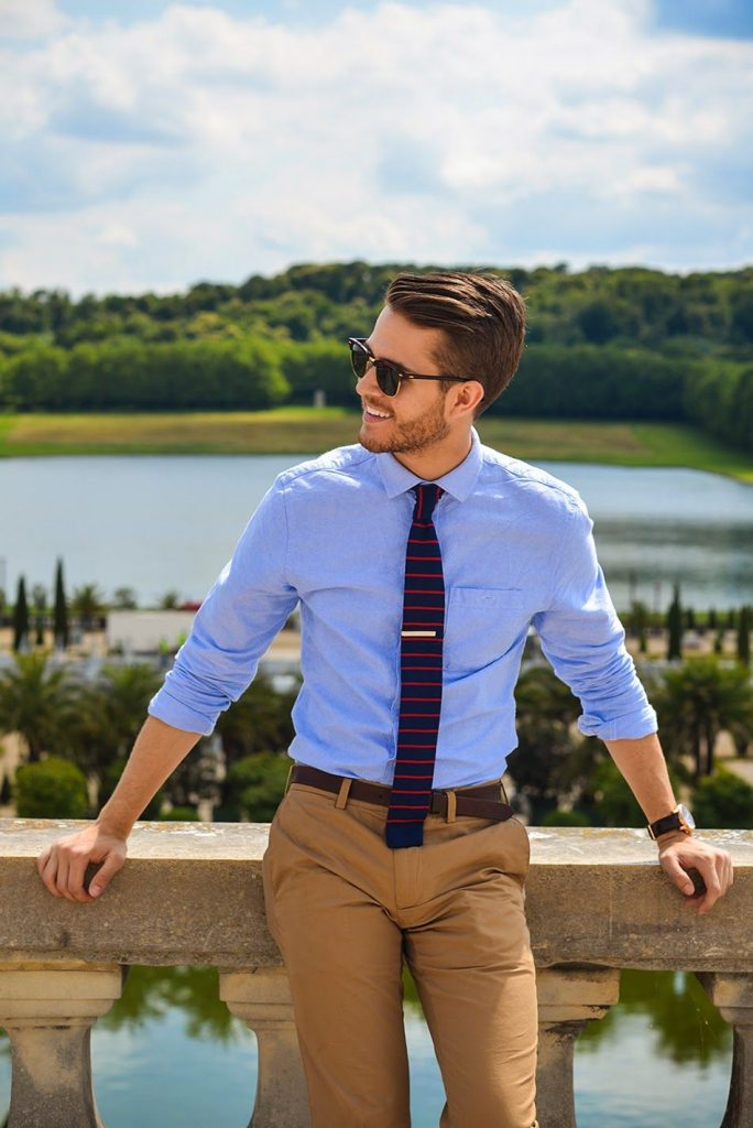 handsome man wearing light blue shirt wedding outfit idea