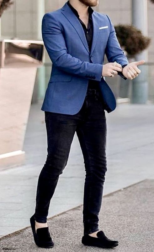 man checking watch wearing skinny tuxedo blazer