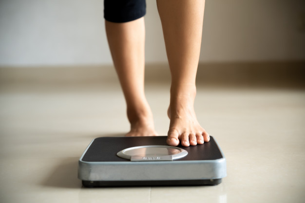 female-leg-stepping-weigh-scales-healthy-lifestyle-diet