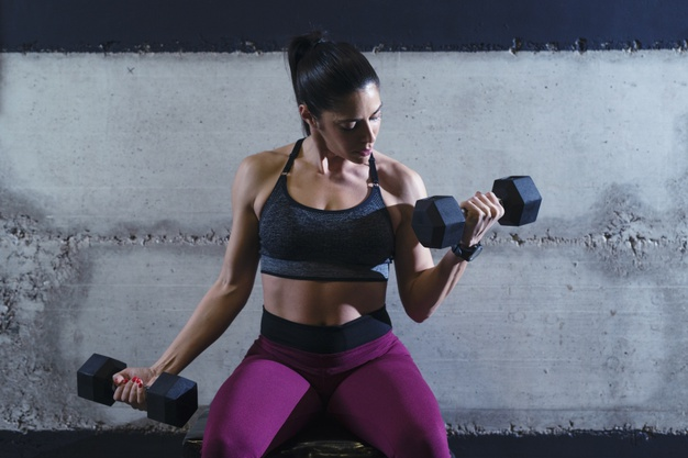woman training dumbbell workout